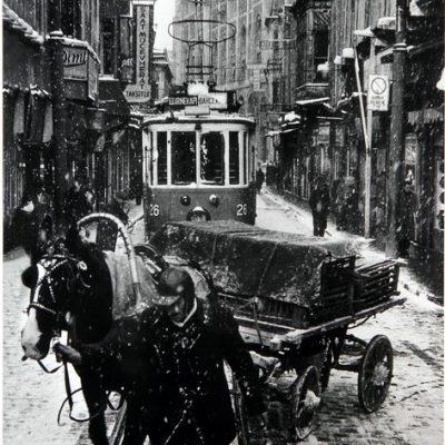 "Ara Güler, Tram and a horse-drawn cart on a winter day in ""Sirkeci"", 1956, 132x90 cm."